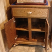 Double door oak cabinet open